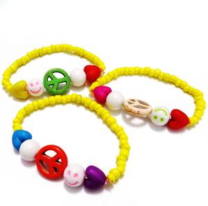 Bratara pt.copii, margele nisip galben si margele multicolore 1 buc