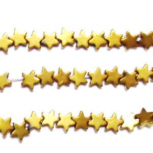 Hematite nemagnetice, placate auriu, stelute 4x2mm 1 buc
