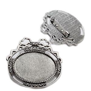 Baza cabochon, argintiu antichizat, brosa, 43x48x2mm, interior 35x25mm 1 buc
